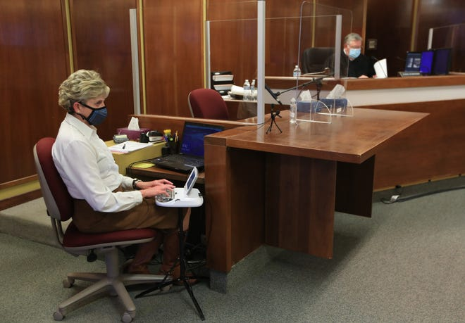 Court reporter Susan Carden Gonzales uses a stenograph as she reports the words that are said in the courtroom and on Zoom during a hearing with Judge Keith Schroeder on Tuesday morning at the Reno County courthouse.