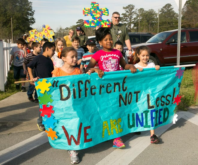 Students and family members from Johnson Primary School at Camp Lejeune march in support of autism awareness back in 2014.