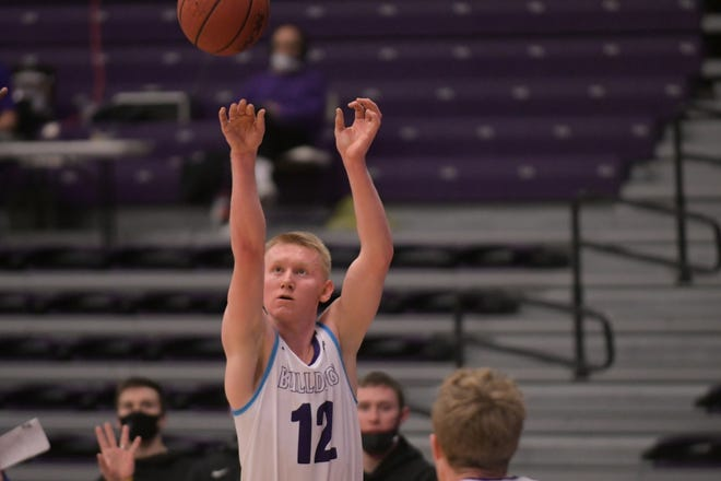 Truman's Masen Miller knocks down a 3-pointer in the first half of Wednesday's loss to Indianapolis.