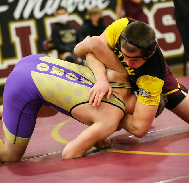 Stow-Munroe Falls' 220-pounder Teddy Gregory turns an opponent onto the mat during a match earlier this season. Gregory was one of two Bulldogs to win his weight class Feb. 27 at the Division I district tournament at Euclid.