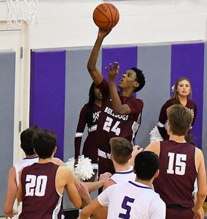 Woodridge forward Esseck Bryant puts up a shot during the Bulldogs' 62-56 win at LaGrange Keystone Feb. 26 in a Division II sectional final game.