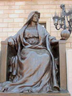 This statue in front of the Boston Public Library in Copley Square personifies science.