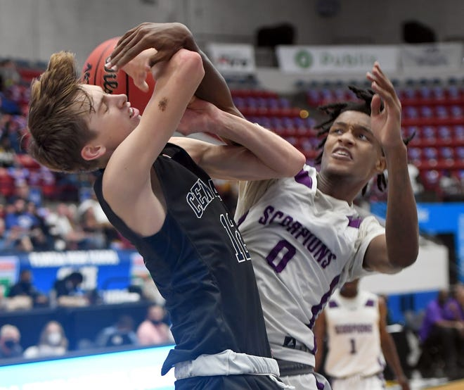 Central's Trenton Moye (15) is fouled by Crossroads Academy's Kris Parker (0) during their Class 1A semifinal in the Florida High School State Championships at The RP Funding Center in Lakeland.