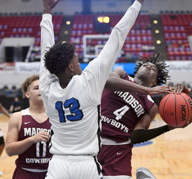 Madison County's Zarrion Robinson (4) shoots against Wildwood during their Class 1A semifinal in the Florida High School State Championships at The RP Funding Center in Lakeland.