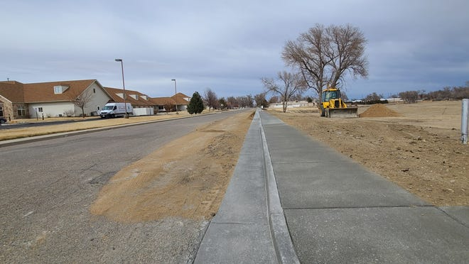 A new curb and gutter were installed on 10th St. and Barnes Avenue.