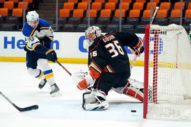 St. Louis Blues center Oskar Sundqvist, left, scores past Anaheim Ducks goaltender John Gibson (36) during the first period of an NHL hockey game Wednesday, March 3, 2021, in Anaheim, Calif.