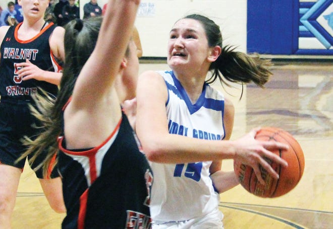 Climax Springs' Autumn Wallace looks to get past a Walnut Grove defender and go up for a shot in a sectional game on March 3 in Climax Springs. Wallace led the team with 10 points in her final game as a Cougar.