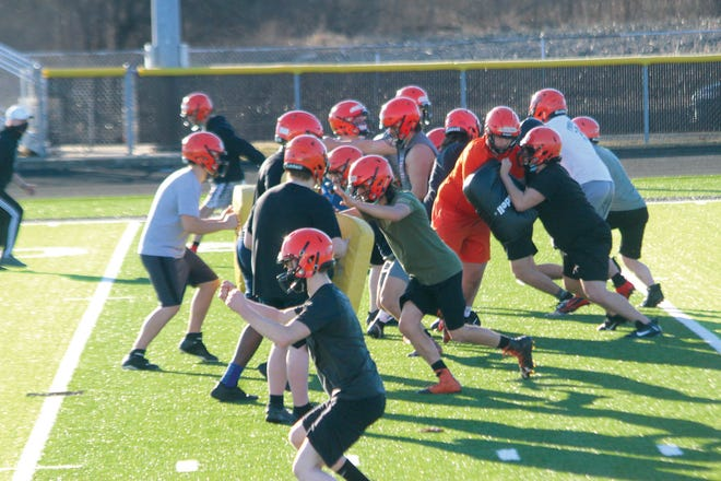 The Macomb boys football team partake in a drill on Wednesday during the first day of football practice. All across the state of Illinois, spring sports held the first  practices of the season.