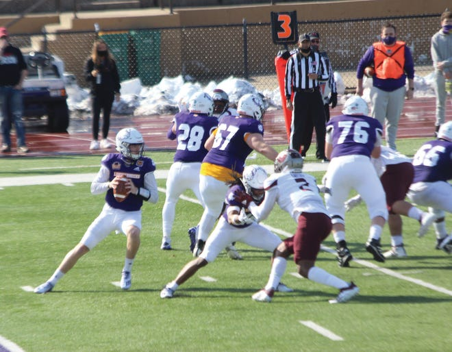 Western Illinois quarterback Connor Sampson drops back to pass during a game against Missouri State.