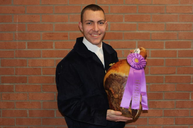 Timothy Umstead had the grand champion ham at Wednesday's Mineral County Ham, Bacon and Egg Show at the Mineral County Technical Center. The annual sale will be March 11 and will be online only at sconlinesales.com.