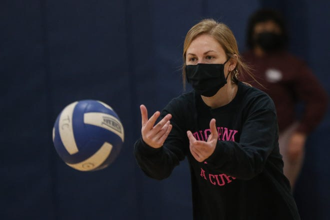 Tri-County girls volleyball coach Stephanie Caffrey tosses a volleyball during practice at Tri-County in Franklin on March 3.