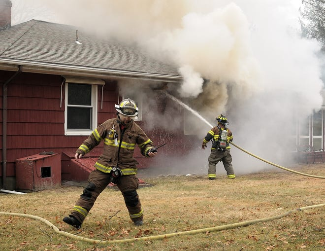 Uxbridge Fire Chief Tom Dion fights a fire in 2018.