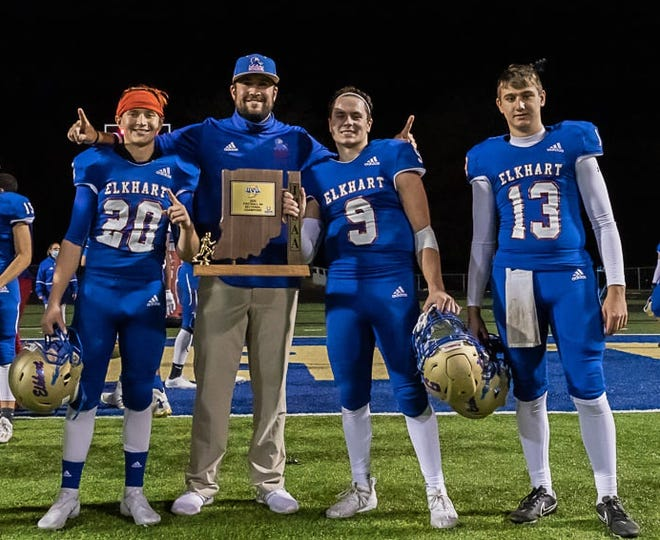 New Gibraltar Carlson football coach Landon Grove celebrates an Indiana Sectional championship last fall with Elkhart players (left to right) Sam Russo, Cam Wiltfong and  Brady Kruper.