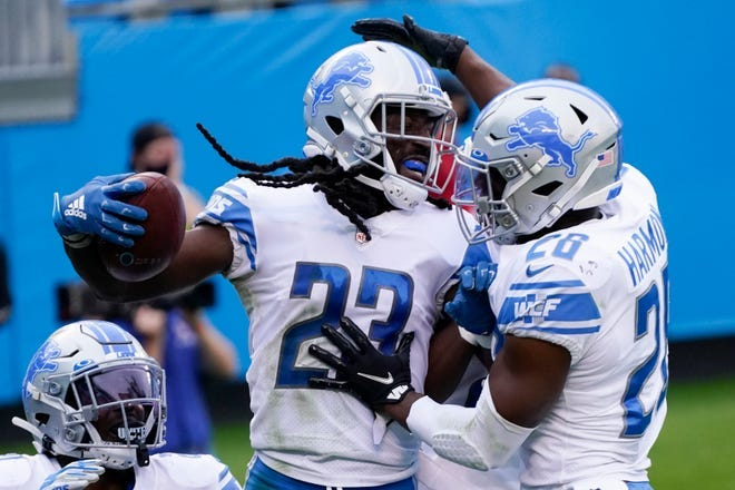 Lions cornerback Desmond Trufant celebrates with strong safety Duron Harmon (right) after an interception in the end zone during the second half of the Lions' 20-0 loss to the Panthers on Sunday, Nov. 22, 2020, in Charlotte, North Carolina.