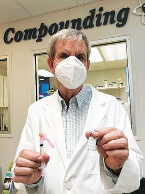 Pharmacist James Munsey prepares.