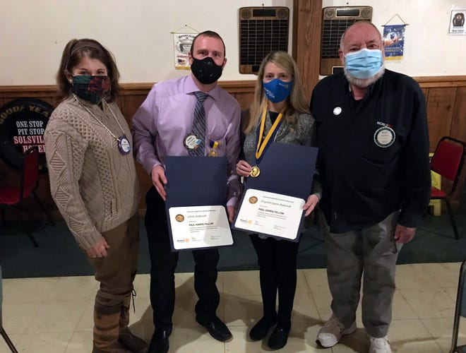 The Oriskany Falls Rotary Club presented Chris and Crystal Jadwick, center, with Paul Harris Fellow awards March 3 at the Hotel Solsville in Madison. With them are chapter President Linda Keever, left, and Past President Bruce Pierce, Crystal's dad.