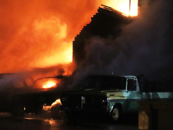 Fire engulfs a motor vehicle and the garage portion of Bernie's Automotive Wednesday evening.