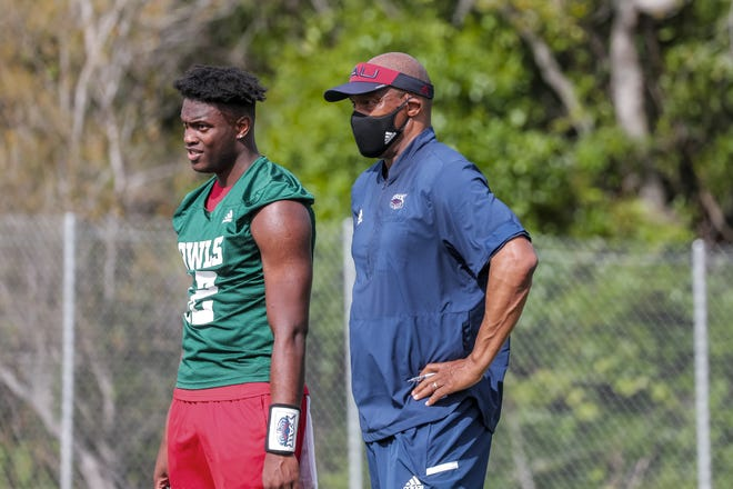 Florida Atlantic offensive coordinator Michael Johnson, right, stands next to his son, quarterback Michael Johnson Jr.