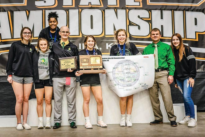 The Pratt High School girls wrestling team poses with hard-earned evidence of a successful season that ended in Salina this past weekend. Keimarla Thompson (back) and (from left) Gracelyn Fleming (manager), Payton Woody, Coach Tate Thompson, Jadyn Thompson, Livia Swift, Coach Ronald Prater and Alyssa Green (manager) celebrated a second overall team placing in state, plus Coach Thompson was named Sportmanship Coach of the Year. He also received an award for Sub-State Coach of the Year.