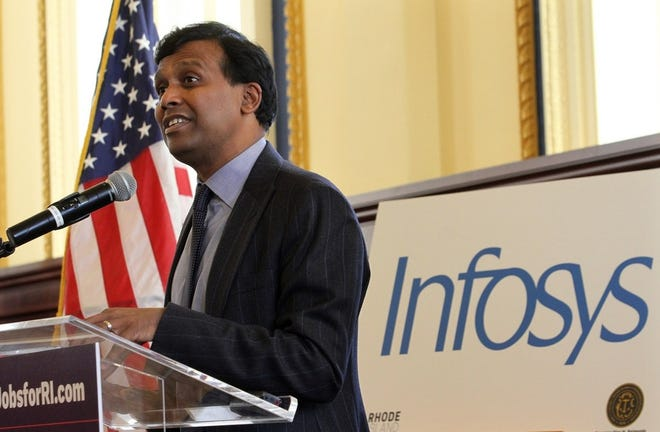 IT services provider Infosys has been approved for $8.5 million in credits to expand offices in Providence and hire 500 people. Ravi Kumar, president of Infosys (above), speaks at a press conference in Providence in 2017, announcing that the company would locate an office in the city.