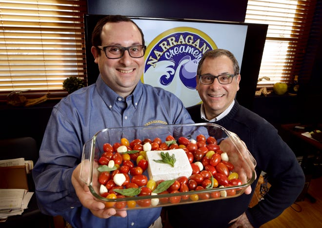 Mark Federico Jr., left, and his dad Mark Federico, of Narragansett Creamery in Providence, saw demand for their feta nearly double in a matter of days.