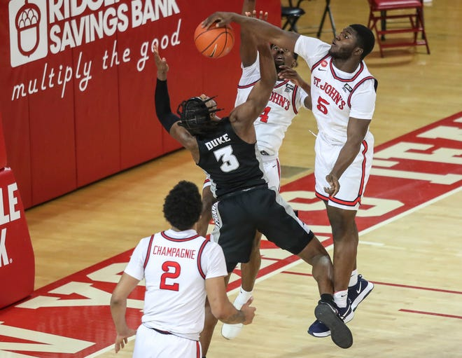 St. John's guard Dylan Addae-Wusu blocks a shot attempt by Providence's David Duke in the second half at Carnesecca Arena on Wednesday night. The Red Storm won, 81-67.