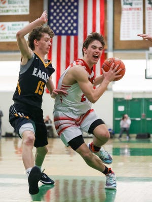Ben Hurd - shown in last season's D-II title game win over Barrington - and the Portsmouth boys basketball team will get to defend their crown after upending East Greenwich in Wednesday's D-II semifinal game.