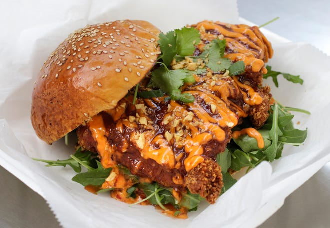 The Kick'n Chick'n sandwich from Ming's Asian Street Food truck. The panko fried chicken thigh is served with arugula, sweet Thai chili sauce, spicy mayo, fried garlic, cilantro and scallions.
