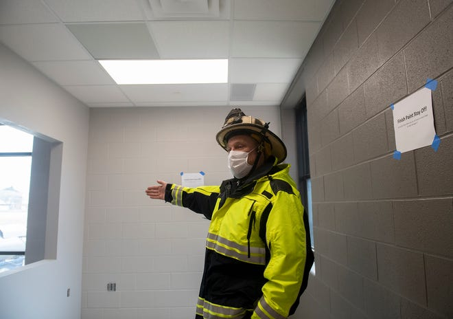 Streetsboro Fire Chief Robert Reinholz leads a progress tour on the new fire station on March 4. .