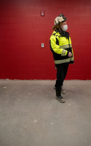 Streetsboro Fire Chief Robert Reinholz leads a progress tour on the new fire station in March. The department officially moved into the new station on Thursday and expects to hold an open house next month.
