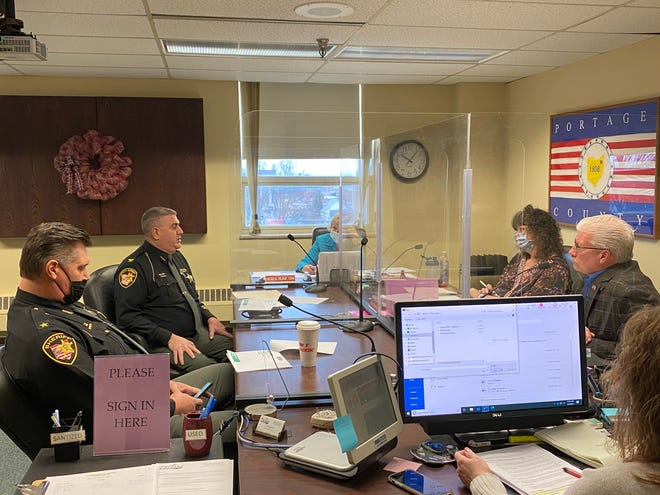 Ralph Spidalieri, chief deputy of the Portage County Sheriff's Office, and Sheriff Bruce Zuchowski addresses Portage County Commissioners Tony Badalamenti, Sabrina Christian-Bennett and Vicki Kline.