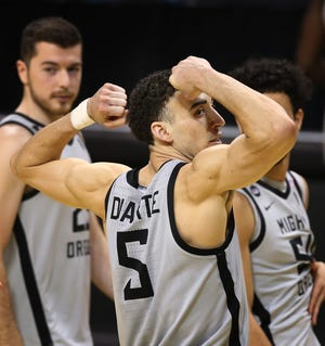 Oregon's Chris Duarte flexes after the win over UCLA in the final regular season home game.
