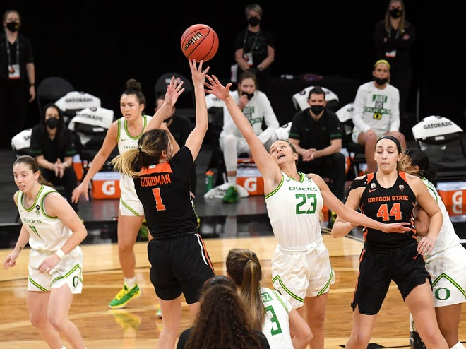 Oregon State's Aleah Goodman shoots over Oregon's Maddie Scheer during the Beavers' 71-64 victory over the Ducks in the Pac-12 Tournament quarterfinals on Thursday in Las Vegas.