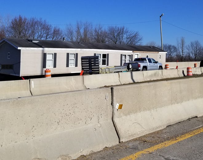 A mobile home left between the northbound and southbound lanes of Interstate 77 in an active construction zone in Canton has been removed.  Lori Steineck / The Canton Repository