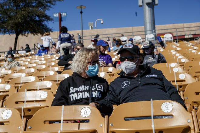 Carey Ortman and her husband Steve Ortman watch the Chicago White Sox play the Milwaukee Brewers during a spring training game at Camelback Ranch on Sunday in Mesa, Ariz.