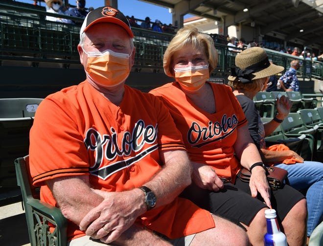 Baltimore Orioles fans Bob and Sherri Bream from Westminster, Maryland, were in the stands for the game against the Red Sox in Sarasota on Thursday. For Bob, this is his 26th Orioles spring training.