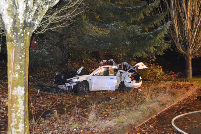 FILE - In this Nov. 17, 2020, file photo provided by the Corvallis Police Department is the scene where an Oregon man crashed a Tesla while going about 100 mph, destroying the vehicle, a power pole and starting a fire when some of the hundreds of batteries from the vehicle broke windows and landed in residences in Corvallis, Ore. Dylan Milota, who survived the crash, was driving the 2019 Tesla S when he lost control. Pandemic lockdowns and stay-at-home orders kept many drivers off U.S. roads and highways in 2020. But those who did venture out found open lanes that only invited reckless driving, leading to a sharp increase in traffic-crash deaths across the country. (Corvallis Police Department via AP, File)