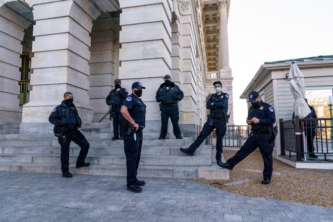 """Heightened security remains around the U.S. Capitol since the Jan. 6 attacks by a mob of supporters of then-President Donald Trump, in Washington, Wednesday, March 3, 2021. The U.S. Capitol Police say they have intelligence showing there is a """"possible plot"""" by a militia group to breach the U.S. Capitol on Thursday. (AP Photo/J. Scott Applewhite)"""