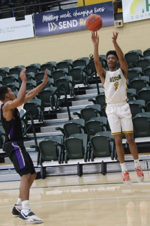Oklahoma Baptist's Jaquan Simms (3) buries a 3-point shot against Ouachita Baptist Wednesday night at the Noble Complex.