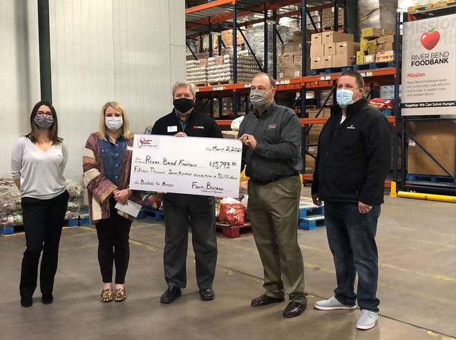 The most recent Bushels for Hunger donation involved, from left: Jenny Brinkmeyer, Chief Development Officer; Leslie Corlett, Director of Corporate and Foundation Giving; Mike Miller, President & CEO of River Bend Foodbank; Jeff Kirwan, IAA District 3 Director; and Mike Secymore, Gold Star FS
