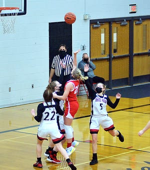 Reese Williams scores two of her game-high 23 points for Colon on Wednesday.