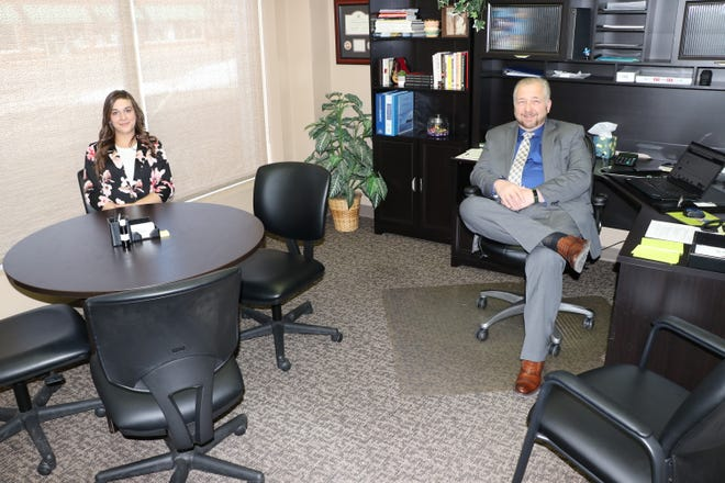 Harley Grimes, executive assistant at Sturgis Area Chamber of Commerce, and executive director Michael Wilson sit in an internet-ready meeting room for business members to use.
