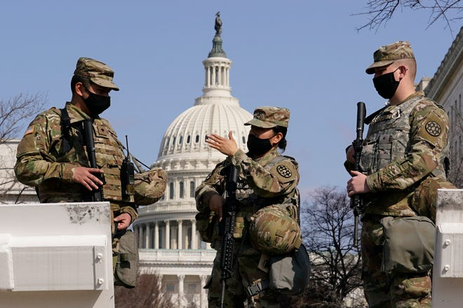 National Guard members stand guard at the Capitol in Washington, Thursday, March 4, 2021.