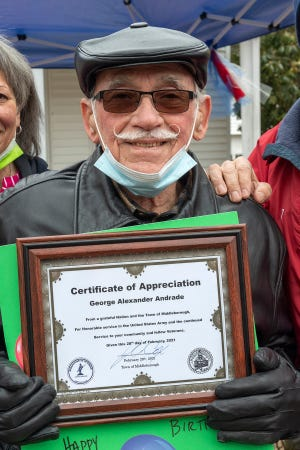 George Andrade, Sr. displays a Certificate of Appreciation from the Town of Middleborough for his service in the US Army and to the local community.
