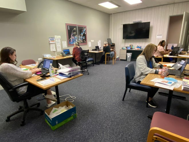 The workers at the Craven County Health Department call center, which director Scott Harrelson refers to as his war room, are 'unsung heroes,' he said. (Bill Hand / Sun Journal Staff)