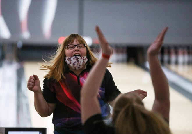 Seaman's Makenzie Millard celebrates after getting a strike during Thursday's Class 5A State Bowling Tournament at Wichita's Northrock Lane. Millard finished fourth with a 612 series.