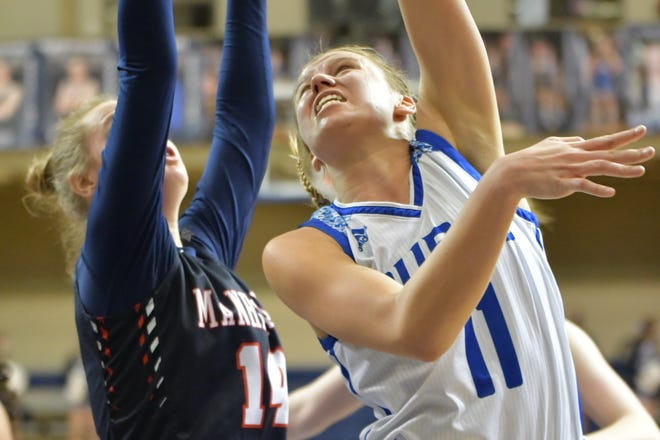 Washburn Rural's Emma Krueger goes up for a basket against Manhattan's Taylor Claussen during Wednesday's Class 6A sub-state semifinal at Rural. The Junior Blues won 50-36.