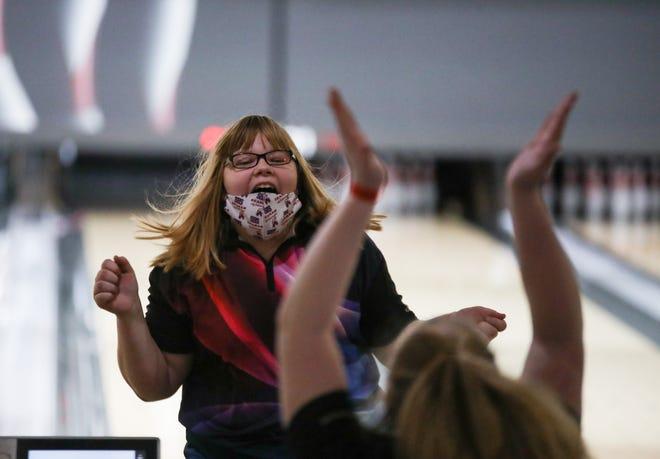 Seaman's Makenzie Millard celebrates a strike at the Class 5A State Bowling Tournament at Wichita's Northrock Lanes.