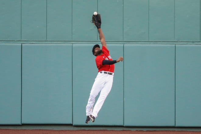 Jackie Bradley Jr. won't be making plays like this for the Red Sox anymore, as the outfielder has signed with the Milwaukee Brewers with a $24 million, two-year contract.