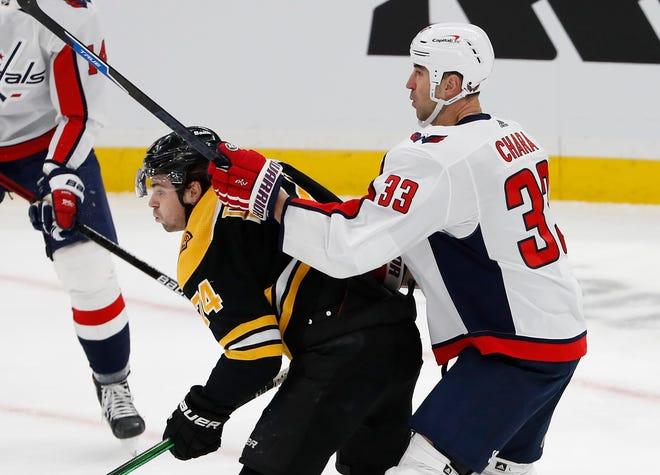 Capitals defenseman Zdeno Chara (33) checks Bruins left wing Jake DeBrusk during the first period Wednesday night at TD Garden.
